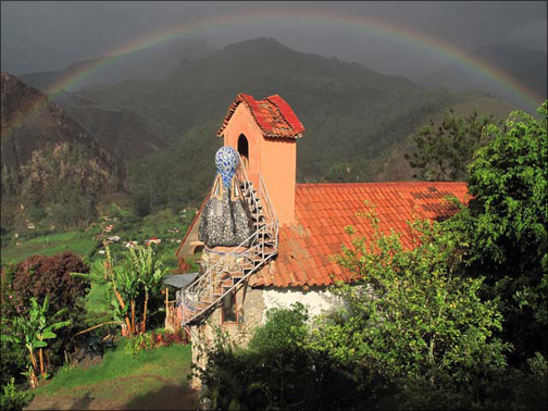 A scene from Montesuenos, with a rainbow.